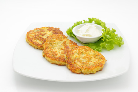 potato: Potato cutlets with sour cream isolated on white