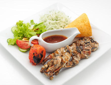 phuket food: Grilled frogs with crisp loaf and spicy sauce isolated on white