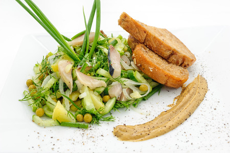 phuket food: Marinated herring with greenery, mustard and fried bred isolated on white