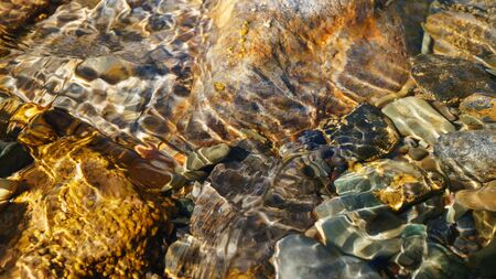 lucid: Crystal clear water of small brook in Altai steppe in Chagan-Ouzun place Stock Photo