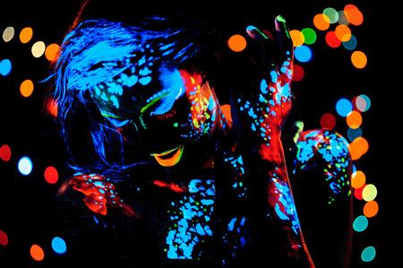 portraiture: Girl with neon paint bodyart portrait, studio shot