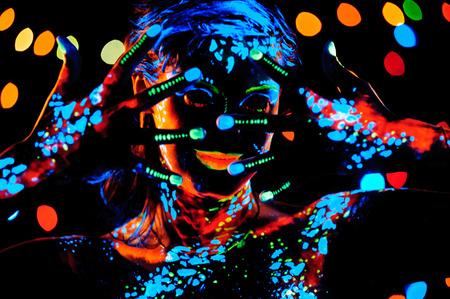 luminescent: Girl with neon paint bodyart portrait, studio shot