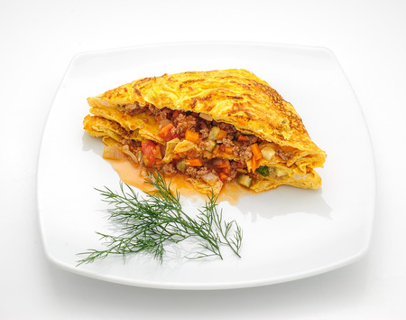 phuket food: Omelette Thai style with vegetable filling isolated on white