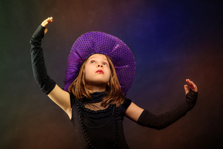 chaplet: Young girl at Halloween party with hat and chaplet Stock Photo