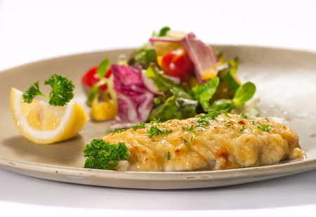 sweet mustard: Fish fillet with vegetable salad  isolated on white