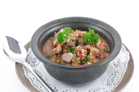 phuket food: Beef stew with celery in a stone bowl isolated on white
