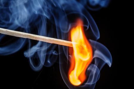 Ignited match and blown off match isolated on black Stock Photo