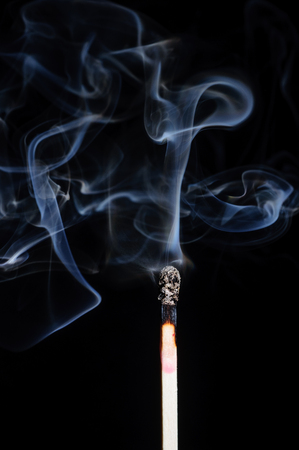 ignited: Ignited match and blown off match isolated on black Stock Photo