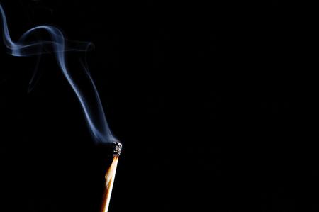 inflammable: Ignited match and blown off match isolated on black Stock Photo