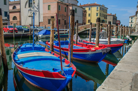 moored: Fisherman boats moored along channel in Chioggia