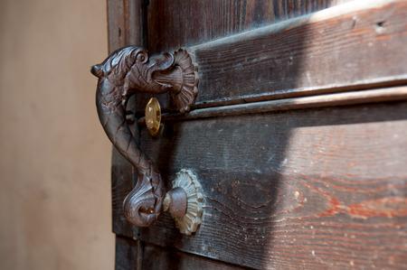 doorknocker: Old doorknobs, doorknockers and handles on ancient doors