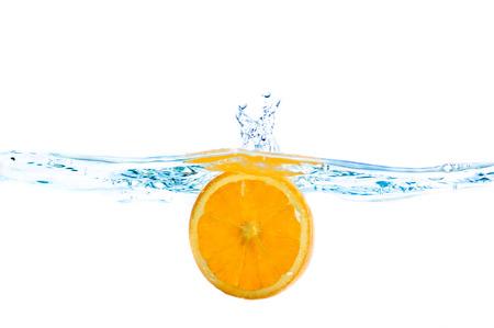 Fresh fruits immerced in clear water, studio shot Stock Photo