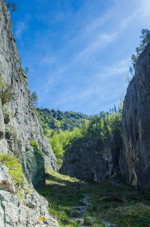Wide ravine with narrow pathway in Altai mountains
