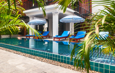Reception and swimming pool of Thai hotel in Phuket Redakční