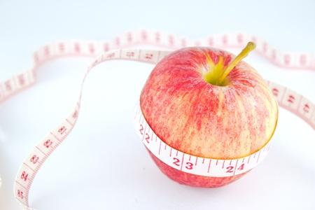 measuring tape around red apple photo