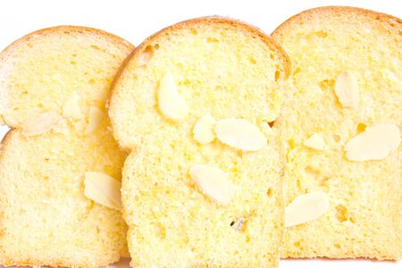 browned: Row of baked butter toast with sliced almonds Stock Photo