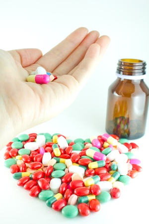 coloful: coloful pills in hand, Heart of pills Stock Photo