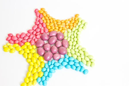 starlike: colorful sweet candies ,star-like on white background
