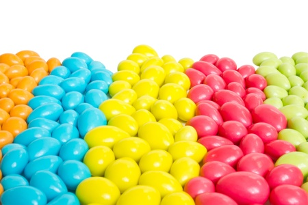colorful sweet candies assorted spreading on white background photo