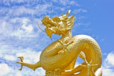 Golden dragon statue with blue sky at Phuket, Thailand photo