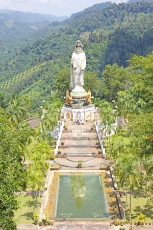 Kuan Yin reflection in the water at Wat BangRiang, south of Thailand photo