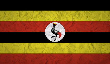 ugandan: Uganda flag with the effect of crumpled paper and grunge