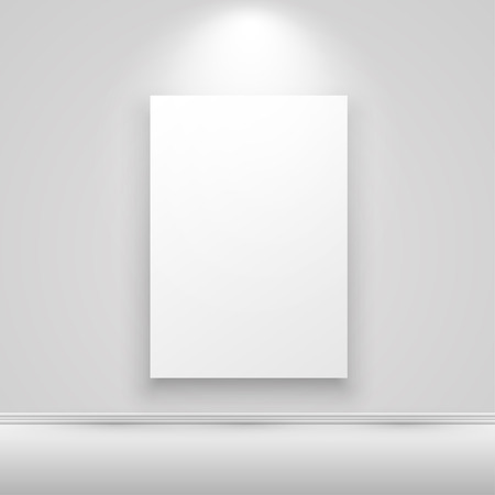 canvas on wall: Blank vertical white canvas on the wall with light