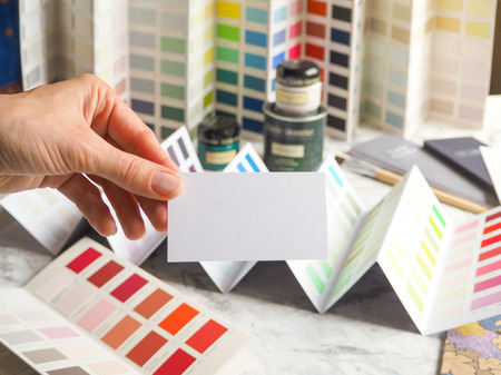 Business card and a large palette of colors. Choose a color from a wide range of paint enamels.