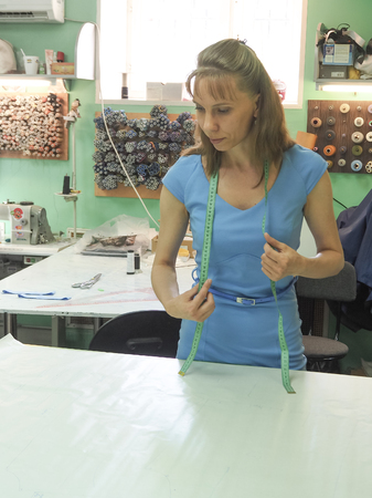 Tailor's business. A woman working on patterns in a small family tailor Stock fotó