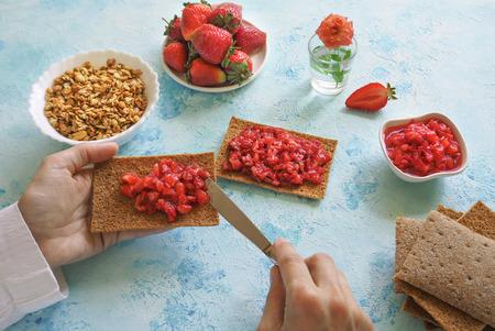 Strawberry Breakfast. Fresh ripe strawberry jam on rye toast