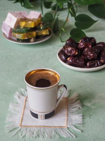 A cup of coffee and Turkish sweets. Sweet food in Ramadan Stock Photo