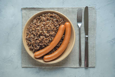 Buckwheat porridge and sausages. Simple Russian country cuisine. Top view