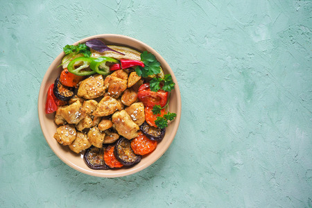 Pieces of baked meat with grilled vegetables on a plate