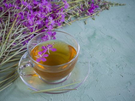 Traditional Russian herbal drink Ivan-tea in a transparent cup. Positively affects the human body