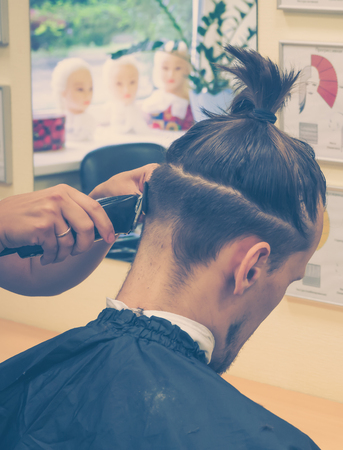 Men's hair makes in the barber shop