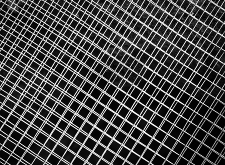 The texture of the silver mesh on a dark background