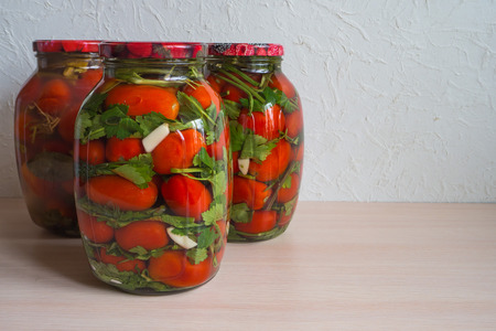 Salted tomatoes in a glass jar. Home preservation