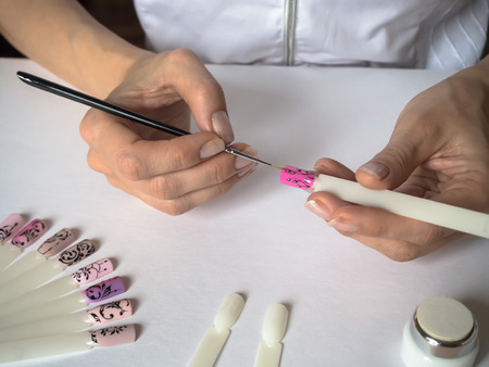 The process of creating a drawing on tips. Nail art design