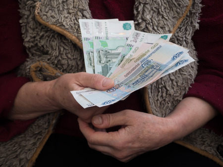 Retired with Russian rubles in his hands. The concept of social security