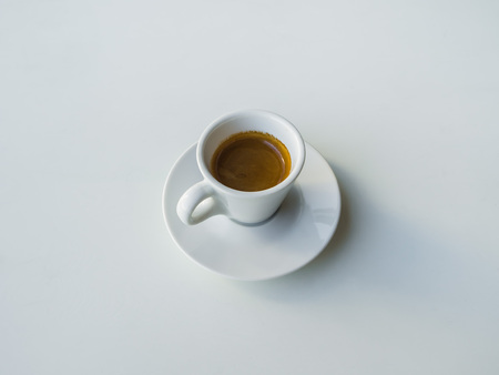 A Cup of strong black coffee on a white table 版權商用圖片