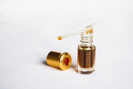 Bottle with extract with agarwood tree fragrances