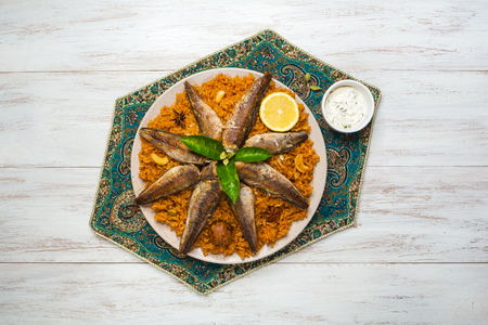 Fish Kabsa - mixed rice dishes that originates in Yemen. Middle eastern food Stock Photo