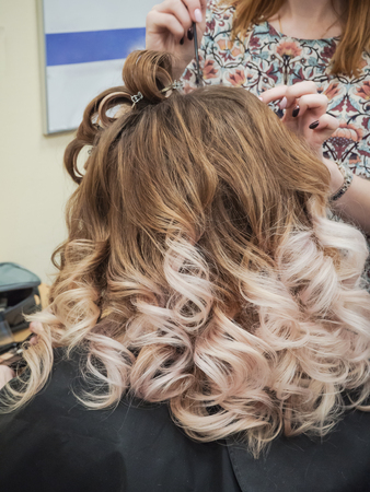 Gradient color on womens curly hair. Close up