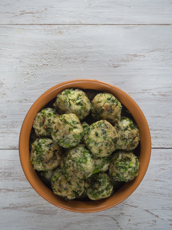 Meatballs with herbs in a clay bowl. Organic food