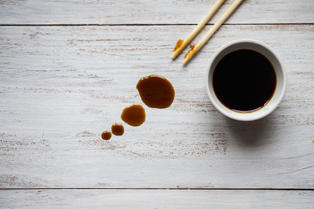Chopsticks and soy sauce on white wooden table Stok Fotoğraf