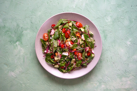 Organic Chard Salad with quinoa and tomatoes. Organic vegetables.