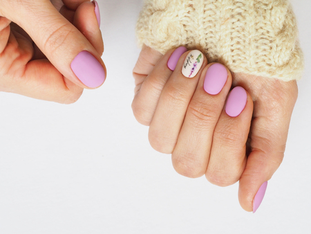 Fashionable lilac manicure design in the hand Stock Photo