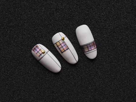 Stylish design on tips. Macro texture of nails