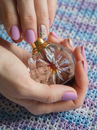 Arabian oud attar essential or agarwood oil fragrances in glass bottles. Imagens