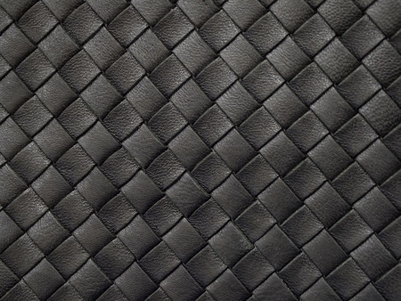The texture of braided black leather. Close up 스톡 콘텐츠